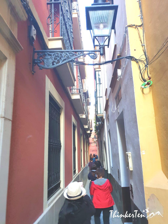 Walking Tour in the Maze of narrow alleys in Santa Cruz Seville, Spain